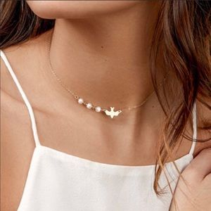 Gold dove pearl necklace
